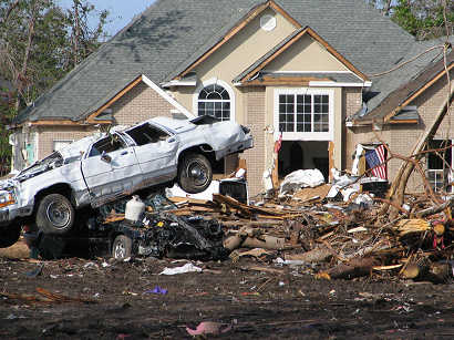 Car in wreckage of house, along gulf coast near Biloxi, Mississippi, photograph copyright Lorelle VanFossen