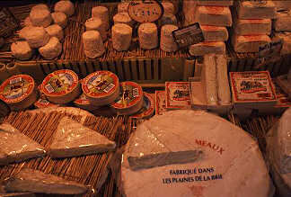 Cheeses in a Paris open market, photograph copyright Lorelle VanFossen