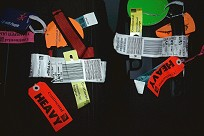 Airline Tags on Suitcases, photograph copyright Brent VanFossen