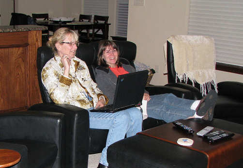 Liz and Holly watch John P's program on Mashable after the event at home