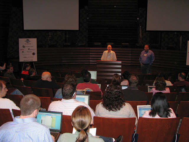 WordCamp Dallas, the very first one in Texas in 2008. Audience sits facing the stage for introductions of the speakers.
