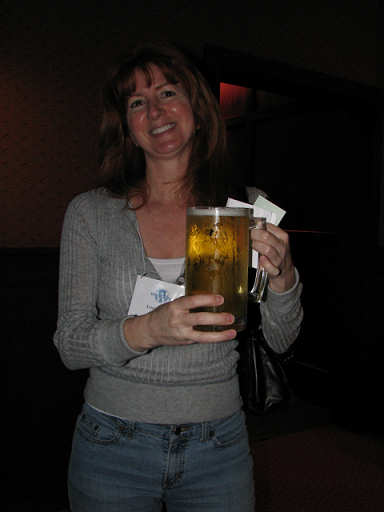 Trisha shows off the huge beers at the pre-WordCamp party