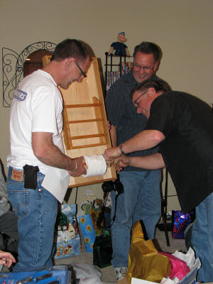 Duke DesRochers fixes one of his famous toilet paper rack holiday presents for his brothers