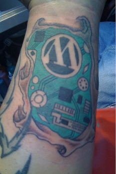 Ed Morita - First core color in background for WordPress logo tattoo