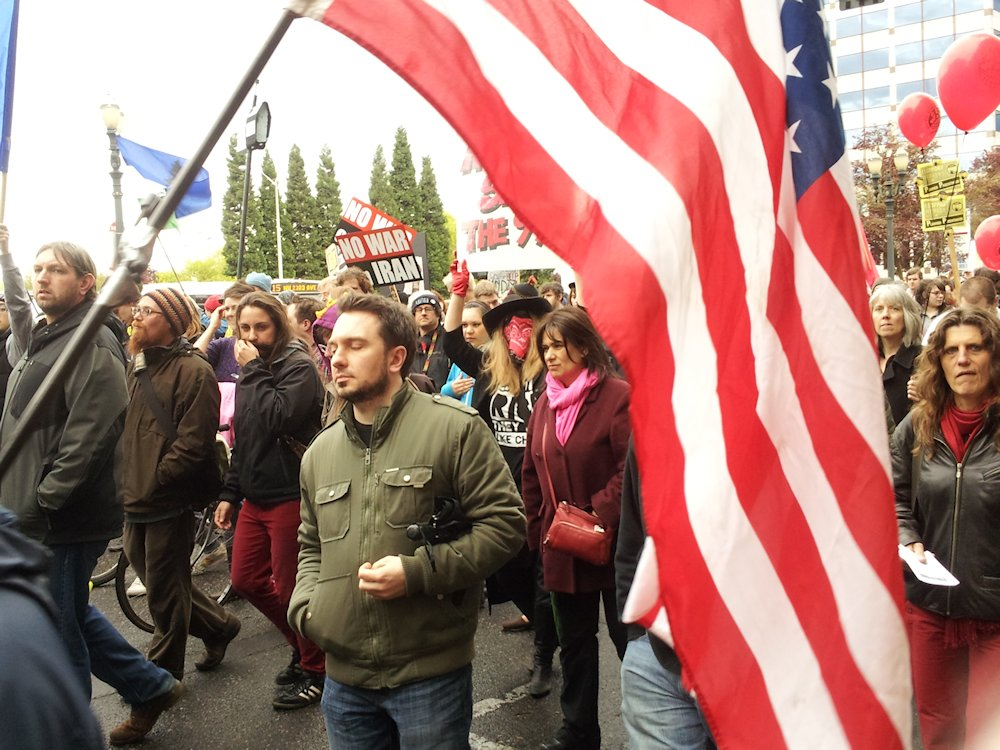 may day pdx protest parade american flag and crowd lorelle