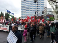 may day pdx protest parade crowd with signs farm workers migrants- lorelle