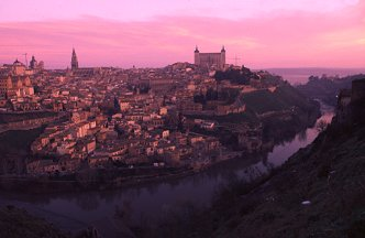 Pink clouds of the sunrise over the old city of Toledo, Spain, photography by Brent VanFossen
