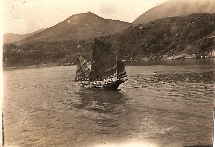 Asian Junk Ship along the coast of Japan, Hong Kong, or China - location unclear. From archives of Howard W. West Sr and Lorelle VanFossen.