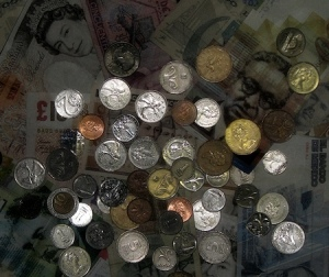 International money bills and coins - copyright Lorelle VanFossen.