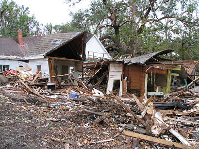 The remains of multiple homes on top of homes, Hurricane Katrina Damage, Ocean Sprins, Mississippi, copyright Lorelle VanFossen.