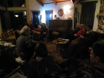 Friends gather at the VanFossens and are entertained by friend, John Doan, on the harp guitar - photography by Lorelle VanFossen.