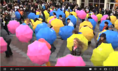 Flash mob dances to Glee mashup of Singing in the Rain and Umbrella in downtown Seattle - watch on YouTube.
